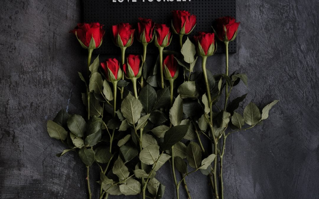 love yourself sign with red roses